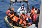 A smuggler has said that migrants - such as these rescued by the Italian navy - who are unable to pay for their journeys across the Mediterranean, are sold to organ traffickers. Photo / AP