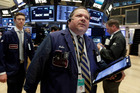 Trader John Santiago, center, walks the floor of the New York Stock Exchange. File photo / AP
