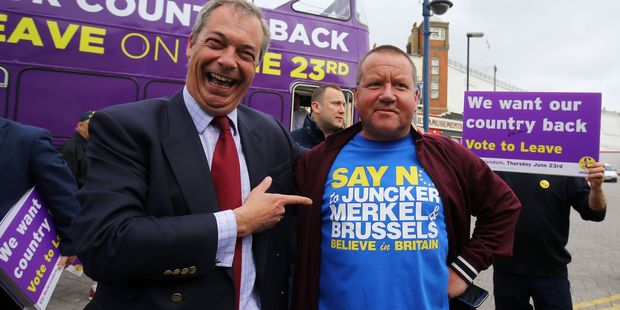 Ukip leader Nigel Farage, left, poses with local Ramsgate taxi driver Chris Bissett during his party's referendum bus tour. Could NZ be next in the push to say 'up yours' ? Photo / AP