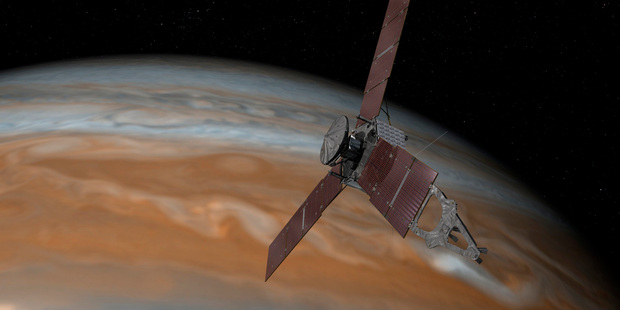 This artist's rendering shows the Juno spacecraft above Jupiter. Photo / AP