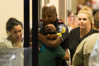 A Dallas Area Rapid Transit police officer receives comfort at the Baylor University Hospital emergency room entrance. Photo / AP