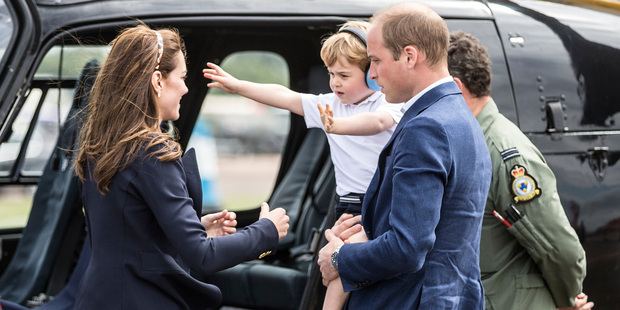 Prince George, his mother Kate and father William check out a Squirrel helicopter. Photo / AP