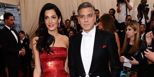 Amal and George Clooney may have spent twice as much renovating their property than what was paid for it in the first place. Photo / AP