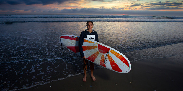 Loading Rio Olympics feature. New Zealand women sevens team captain Sarah Goss with her other passion, surfing, pictured taking time off from training at Mt Maunganui beach. Photo / Brett Phibbs.