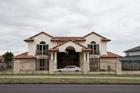 The Masala homes were part of a $34 million asset seizure last year. Photo /  Michael Craig