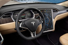 Tesla's Autopilot ghost in the machine doesn't mean you shouldn't hold on to the steering wheel and pay attention to traffic and surrounds.Photo / Supplied