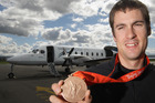 Cycling sensation Sam Bewley shows off his Olympic bronze medal in 2008. Photo / Stephen Parker