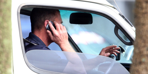 Drivers are still flouting the law when it comes to using cellphones while driving. Photo / Michael Cunningham