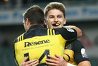 Beauden Barrett of the Hurricanes celebrates scoring a try with team mate Cory Jane during the round 16 Super Rugby match between the Waratahs and the Hurricanes. Photo / Getty Images