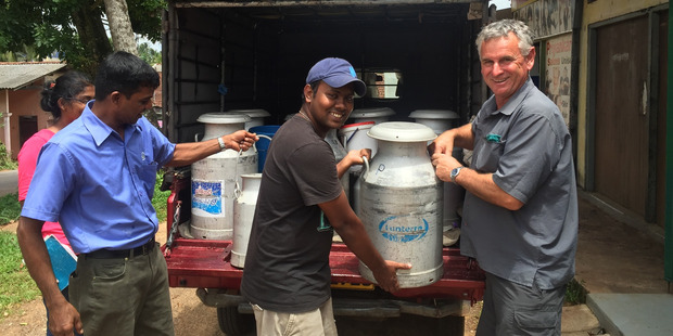 Murray Douglas (right) with a collection truck driver who has picked up the milk from about 20 Sri Lankan suppliers. Photo / Fonterra