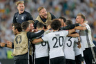 Germany's players celebrate after Jonas Hector scored the winning penalty during the Euro 2016 quarterfinal. Photo / AP