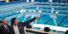 Michel Temer (left) and Rio de Janeiro Mayor Eduardo Paes visit the Olympic Aquatics Stadium at the city's Olympic Park. Photo / AP