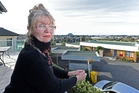 Vivienne Turner and some of the views she will lose if a big building project gets the go-ahead. Photo / George Novak