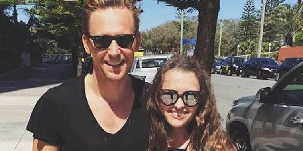 Tom Hiddleston with a fan in Broadbeach last year during filming on Kong: Skull Island. Photo / Instagram