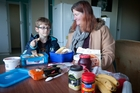 Tracey Wallace-Hutchins, with her son Kris Hutchins, 7, is encouraging parents to bring and extra lunchbox to school for hungry children. Photo / Andrew Warner