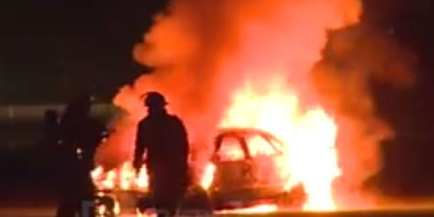 Loading Dramatic footage of fire fighters battling a car fire overnight in Dunedin has emerged. Photo / Southern Stringers
