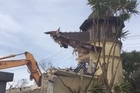 The multimillion dollar house at 81 Sarsfield St is now almost completely demolished. This house rose to prominence when it was abandoned and vandalised in New Zealand's most expensive suburb. By yesterday afternoon, only its distinctive turret was still standing. The house was nicknamed Circus McGurkus for its unusual appearance.