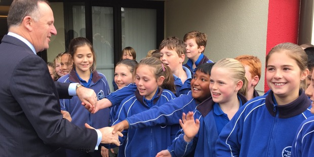 GREETINGS: Prime Minister John Key greets studens from Havelock North Primary School at a function in Havelock North this morning.