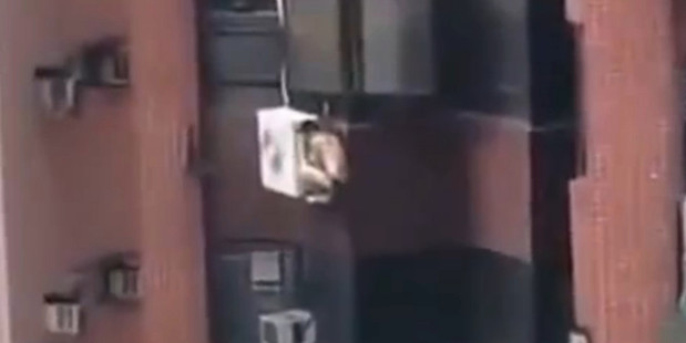 Loading The man reportedly climbed out of a window to hide from his lover's spouse. Photo / LiveLeak