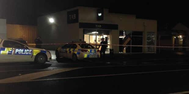 Police at the incident at the South Dunedin TAB. Photo: Linda Robertson / Otago Daily Times