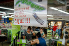 Customers buy state-of-the-art phones for family and friends in Hialeah, Florida. Photo / Angel Valentin