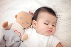 The breathing and heartbeat sounds of the Lulla Doll are designed to soothe a sleeping baby by replicating noises parents make when they're resting.