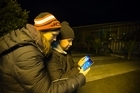 Pokemon Go gamers Jordan Jamieson and Greg Ruaporo of Glenfield hunt for Pokemon at Birkenhead Library last night. Photo/Nick Reed