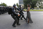 A demonstrator protesting the shooting death of Alton Sterling is detained by law enforcement near the headquarters of the Baton Rouge Police Department. Photo / Reuters