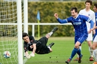 Rovers captain Danny Wilson makes it 3-1 as Petone goalkeeper Shea Stapleton dives in vain in their Central League football match at Park Island, Napier, yesterday. Photo / Warren Buckland