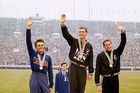 Peter Snell (centre) in the Olympic 1,500-meter run at the Tokyo Summer Games, stand on podium with their awards, Oct. 21, 1964. Photo / File