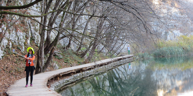 A woman takes a selfie in Plitvice Lakes National Park, where jandals will soon be banned. Photo / Flickr, leiris202