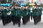 IN STEP: Deco Bay Brass, taking part in the 2016 Deco Bay Festival of Brass, march down Hastings St, Napier, yesterday. PHOTO/DUNCAN BROWN