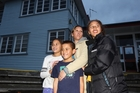 Kimberlee Whaanga has been on a housing waiting list for two months and has four children who are developing health problems sleeping in overcrowded conditions. Pictured with her are Te Atawhai, 9, Teina, 10, and Pare, 12. Photo / Paul Taylor
