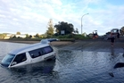 UP SHE COMES: A tow truck was called to winch the van out of the water on Tuesday morning. PICTURE/DANIELLE COLLINGS