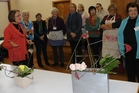 Visiting tutor  Val de Latour of Palmerston North  discusses the principles of modern floral design with members of the Dannevirke Floral Art group last week. Photo / Christine McKay