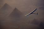 Solar Impulse 2 flies over the Giza Pyramids as it nears the end of its 3745km journey from Seville to Cairo. Photo / AP