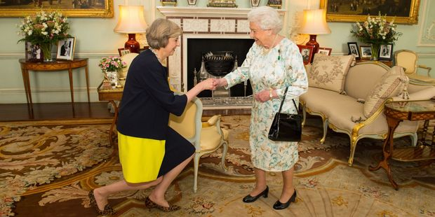 The Queen welcomes Theresa May at the start of an audience in Buckingham Palace, London. Photo / AP