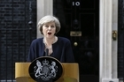 New British Prime Minister Theresa May speaks to the media outside her official residence,10 Downing Street in London.