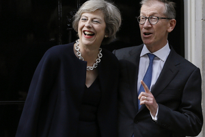 New British Prime Minister Theresa May and her husband Philip May stand on the steps of 10 Downing Street. Photo / AP