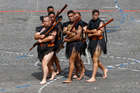 Maori warriors from New Zealand lead a march on the Champs Elysees avenues during the Bastille Day parade in Paris, Thursday, July 14, 2016. Photo / AP