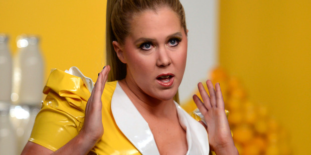 Amy Schumer reveals her first sexual encounter wasn't consensual in a new interview with Marie Claire. Photo/AP