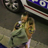A man holds a child after a truck plowed through Bastille Day revelers in the French resort city of Nice, France. Photo/AP