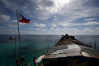 A Philippine flag flutters from the deck of the Philippine Navy ship LT 57 Sierra Madre off Second Thomas Shoal in the South China Sea. Photo / AP