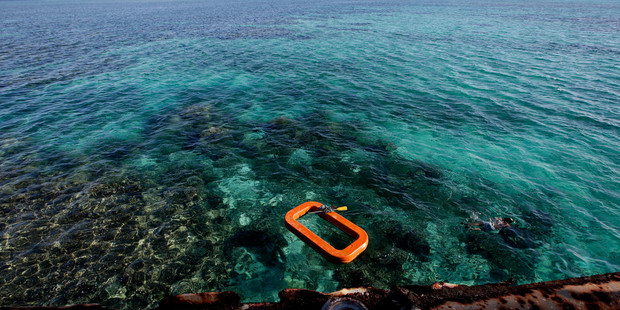 A Philippine Marine swims in the waters of Second Thomas Shoal in the South China Sea. Photo / AP