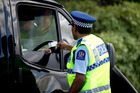 Forty-nine drivers were seen using their mobile phones, and a further eight drivers were not wearing their seat belts this week in Tauranga. Photo/File