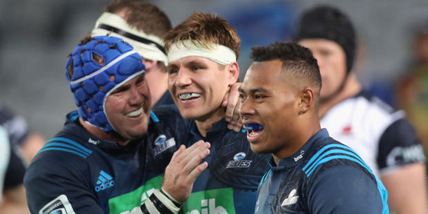 Piers Francis of the Blues (C) is congratulated on his try from James Parsons (L) and Tevita Li (R). Photo / Getty Images.