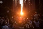 People take photographs as they view the 'Manhattanhenge' sunset. Photo / Michael Appleton, Mayoral Photography Office NYC