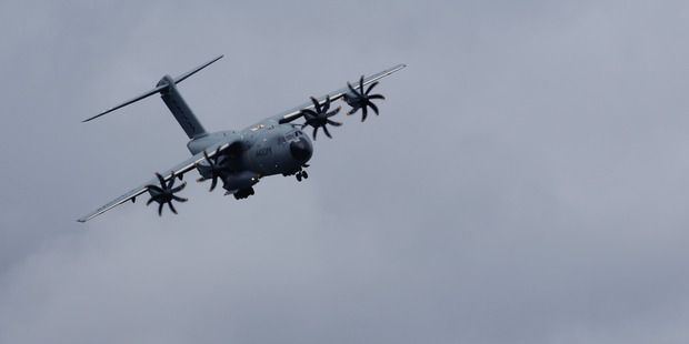Loading An Airbus SE A400M military aircraft performs a flying display at the Farnborough International Airshow. Bloomberg Photo / Luke MacGregor