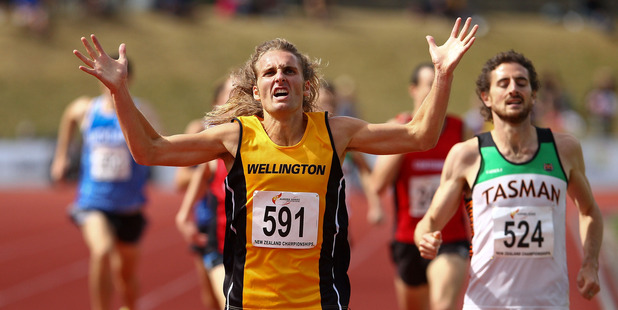 Hamish Carson celebrates winning the 1500m at the New Zealand track and field champs. Photo / Getty Images