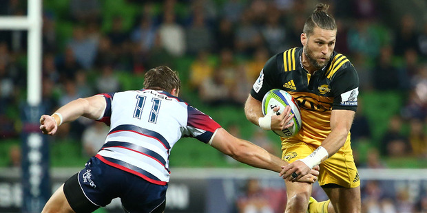 Cory Jane of the Hurricanes runs with the ball during the round eight Super Rugby match against the Rebels. Photo / Getty